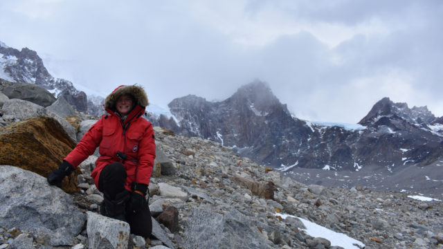 Mia Vandervilt wearing a winter parka on top of a mountain
