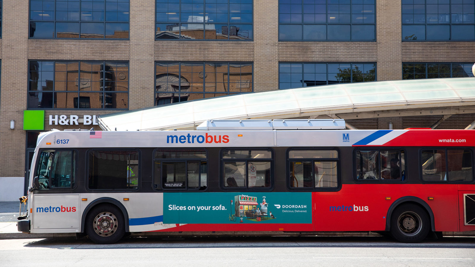 A DC Metrobus makes a stop in the city.