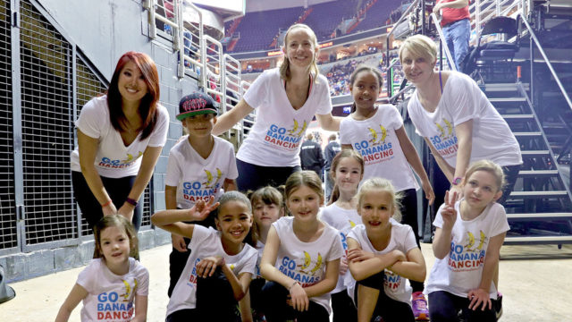 Susannah Pierce Keefe poses with two adults and a group of preschoolers.