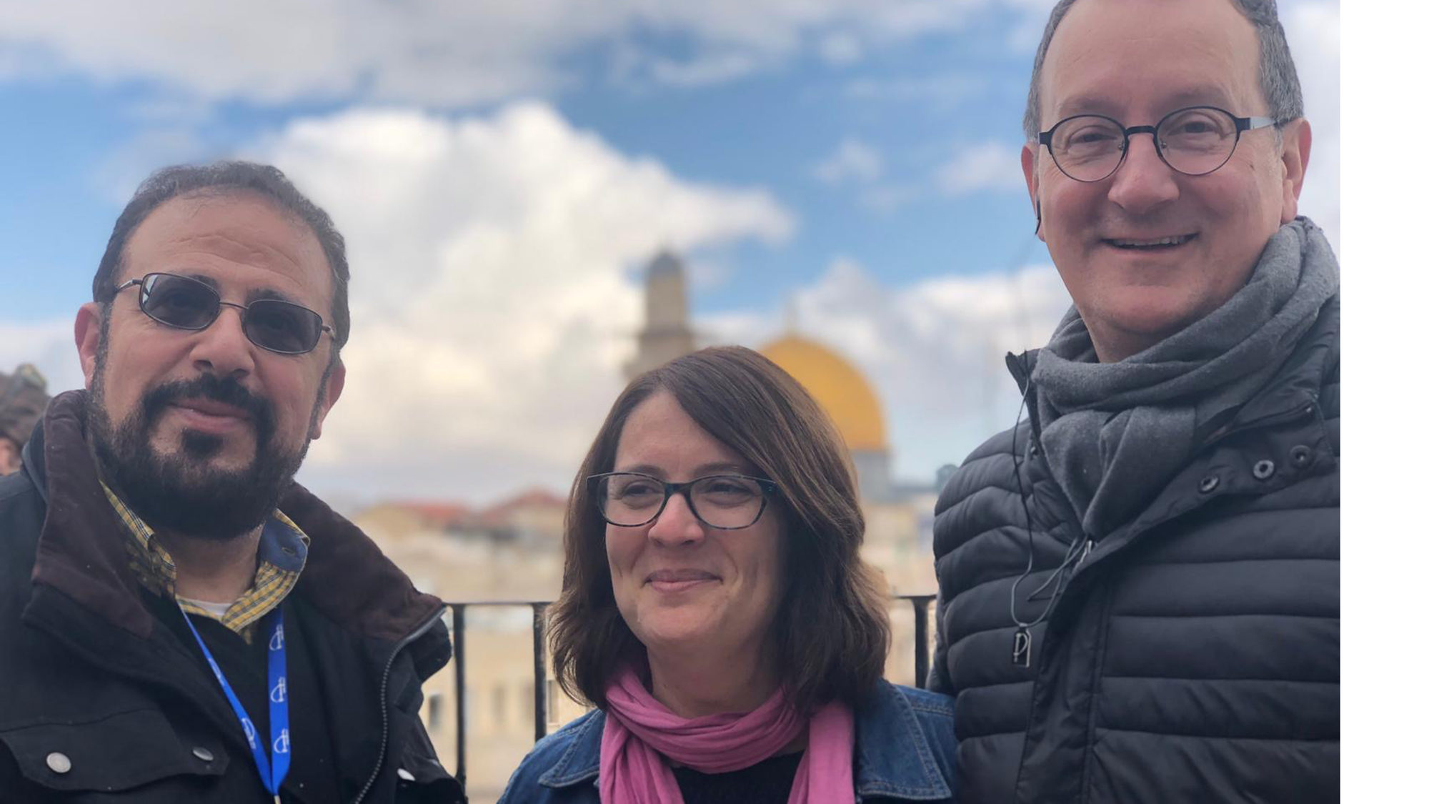 Yahya Hendi, Rachael Gartner and Mark Bosco in front of the Dome of the Rock in the Holy Land