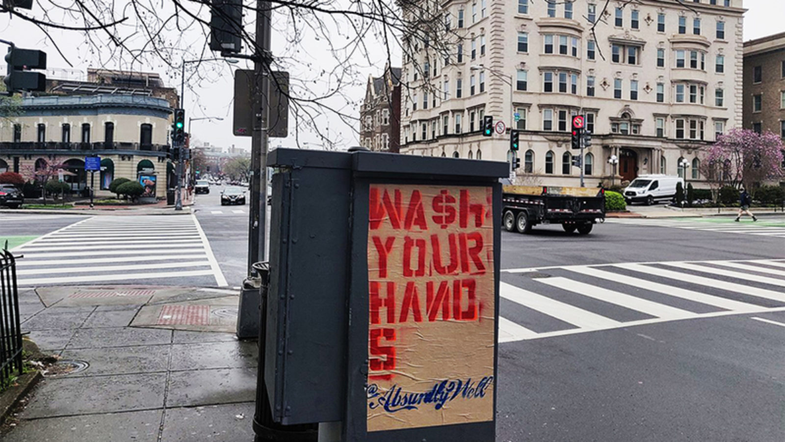 Sign on street that says Wash Your Hands Absurdly Well