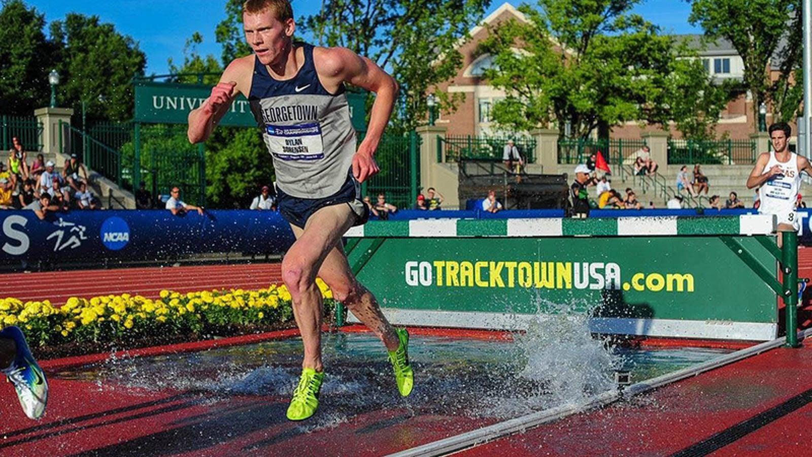 Dylan Sorensen runs on a track outside. Photograph by Michael Scott