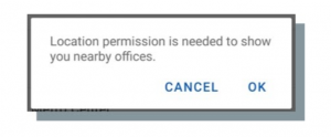 """A pop-up text box that says """"Location permission is needed to show you nearby offices. Cancel. Ok."""""""