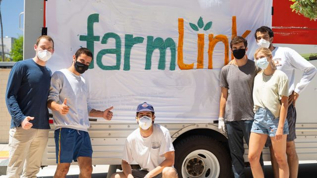 Six students stand in front of a banner that reads FarmLink.