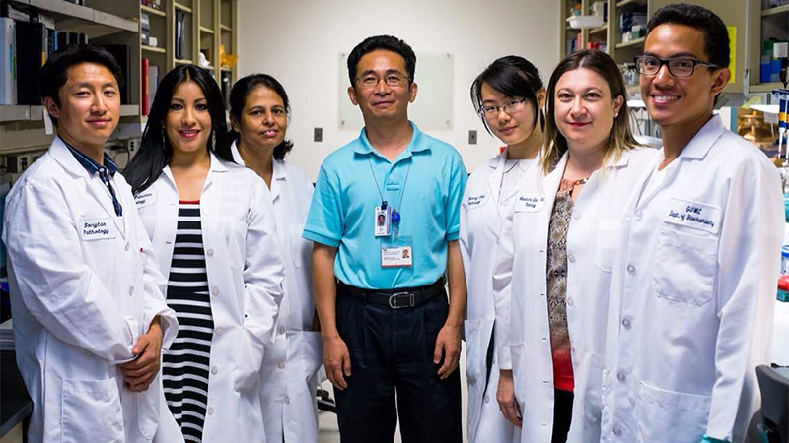 Dr. Xuefeng Liu and his research team stand together in his lab