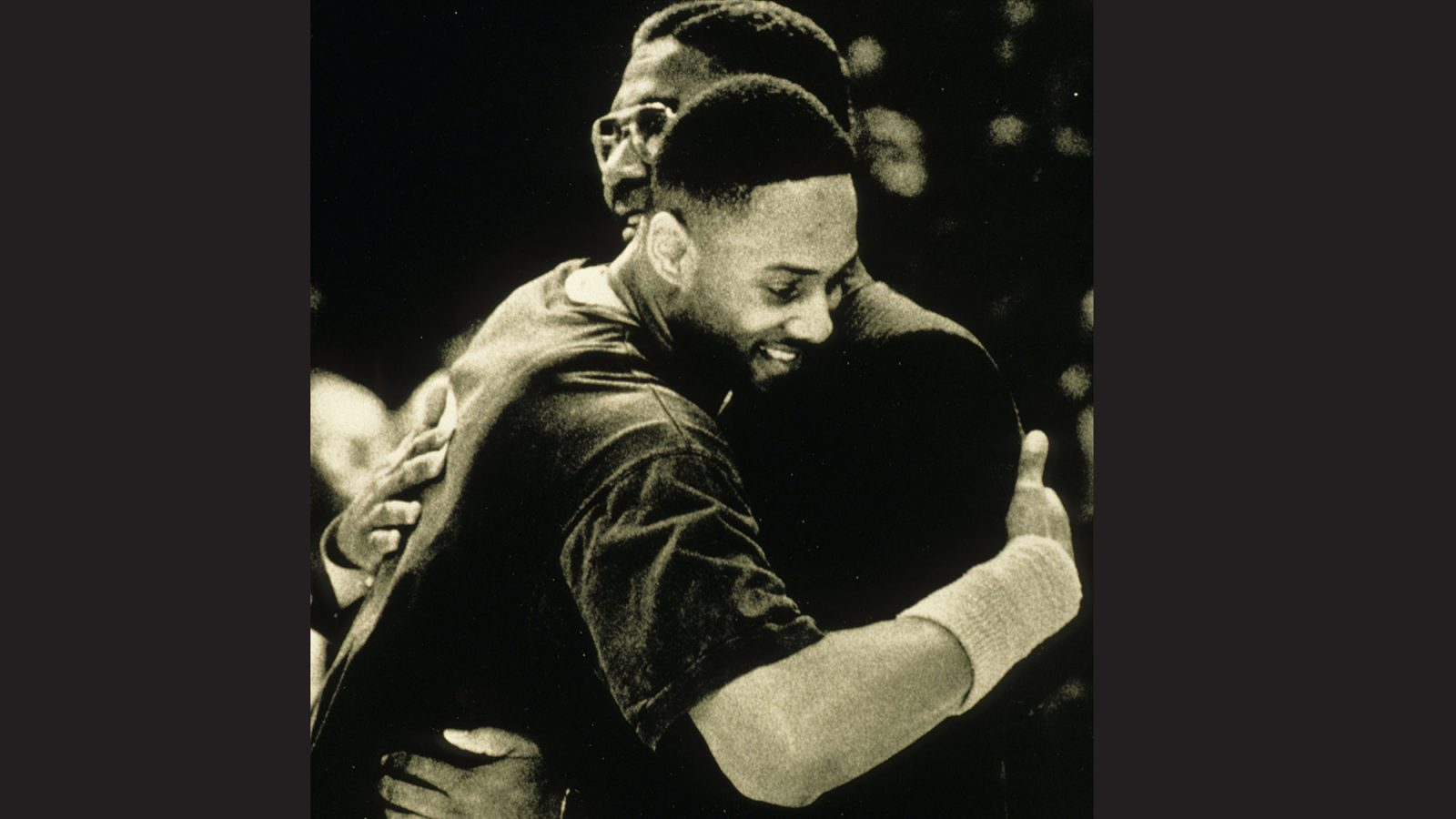 John Thompson Jr. and Alonzo Mourning embace.