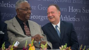 John Thompson Jr. sits with John J. DeGioia as they share a laugh.