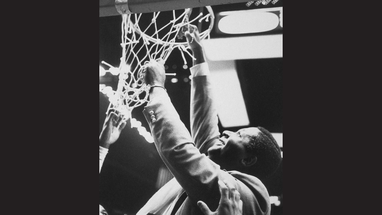 John Thompson Jr. cuts the basket ball net after victory