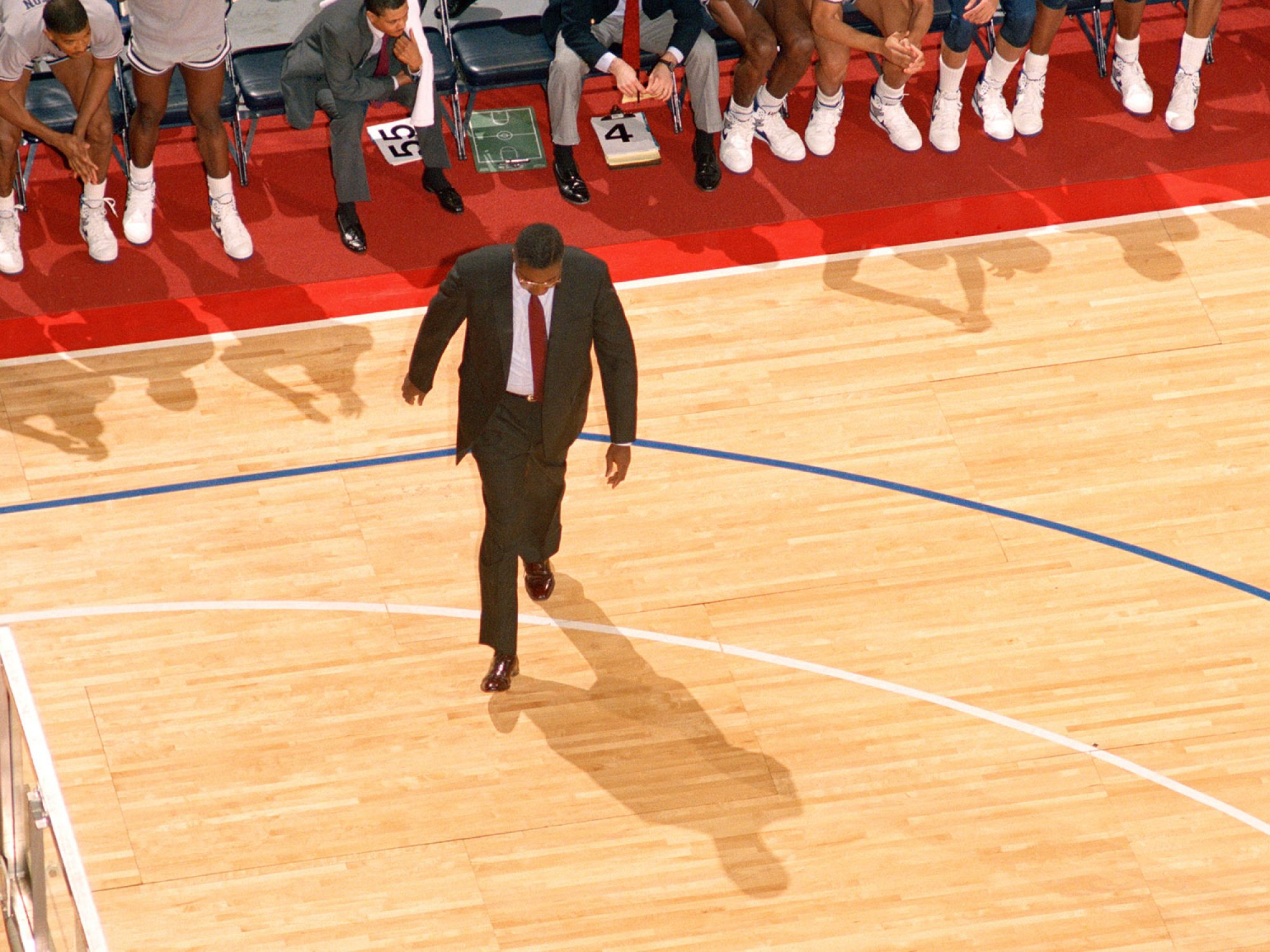 An aerial view of John Thompson Jr. walking across the basketball court.