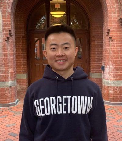 Bryan Zou wearing a Georgetown sweatshirt