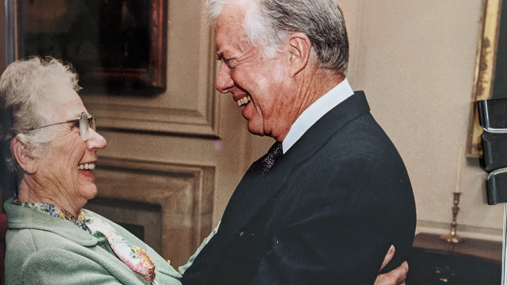 Lillian Brown and President Jimmy Carter smile at one another