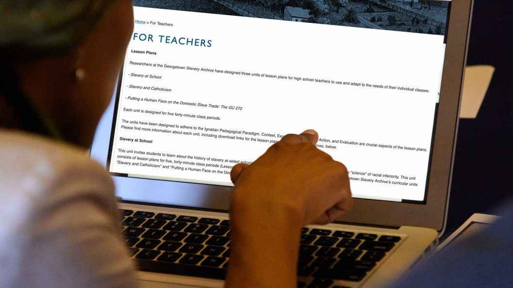 Woman pointing to a oomputer For Teachers Lesson Plans and other information