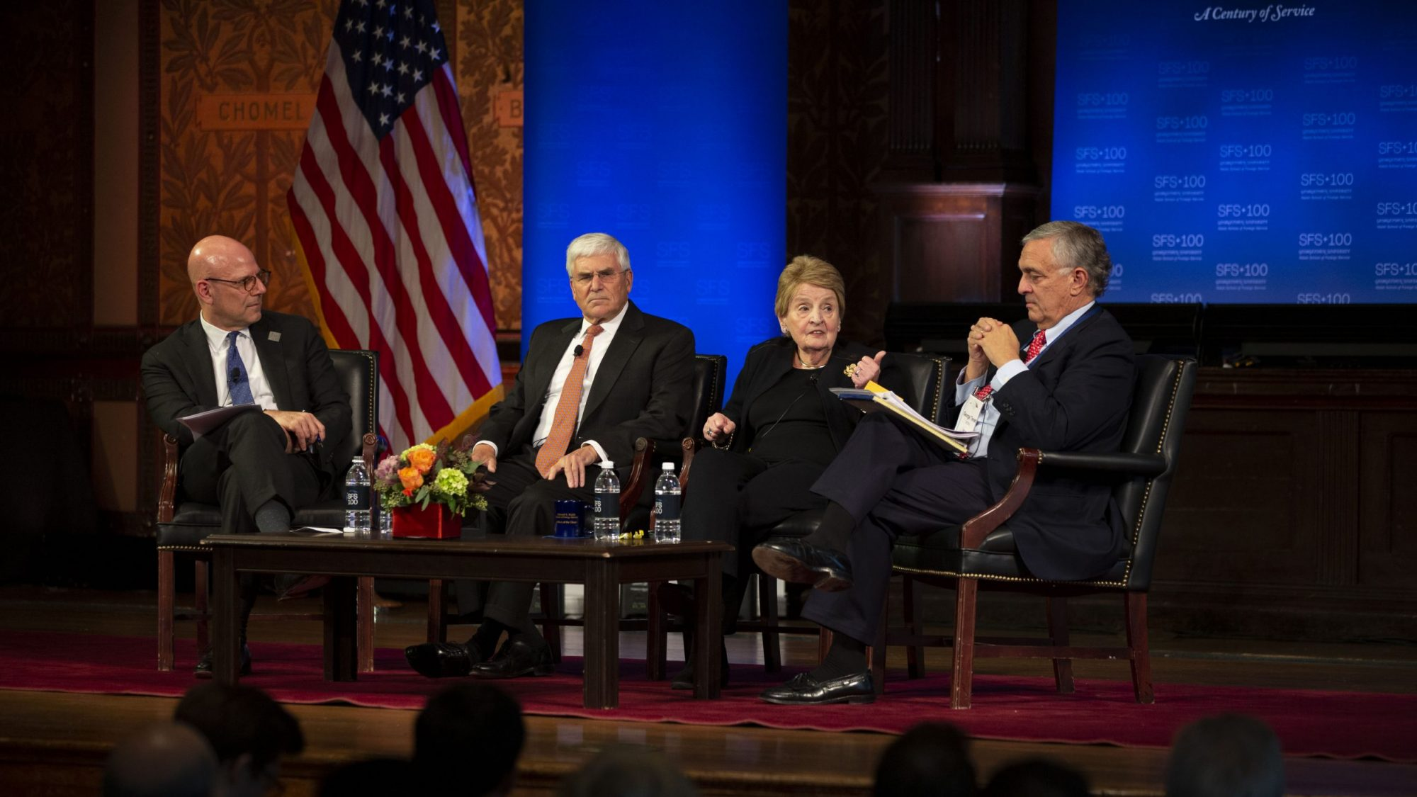 A panel featuring Joel Hellman, George Casey, Madeleine Albright, and George Tenet