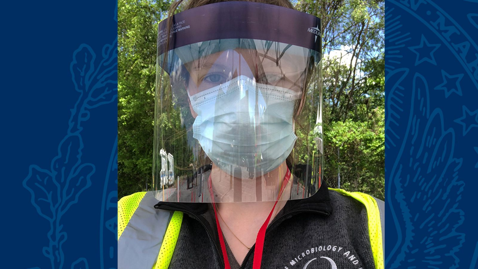 Suzie Stephenson wears a protective face mask and shield.