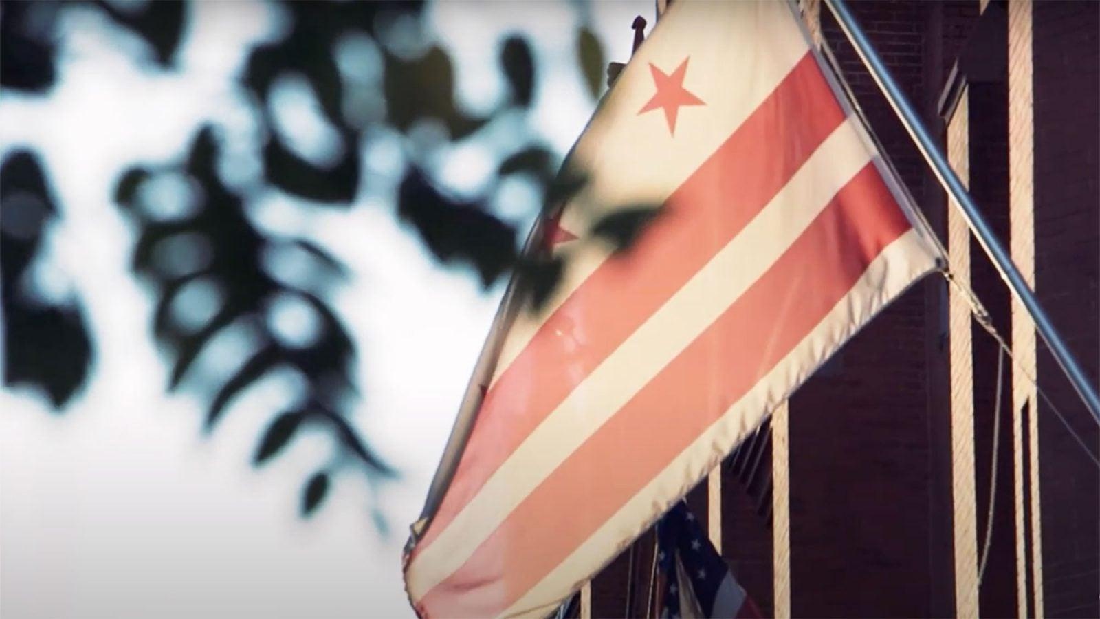 A DC flag hangs outside.