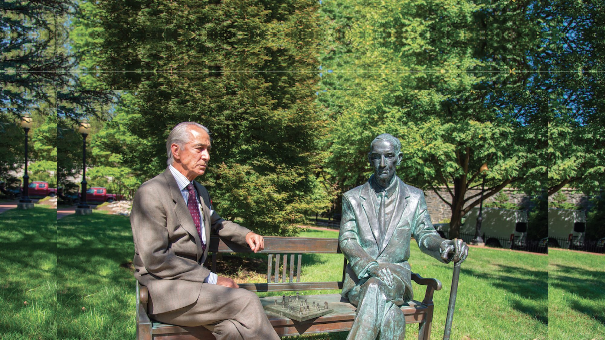 Oscar-nominated actor David Strathairn sits on the iconic commemorative bench with statue honoring Holocaust witness, Polish World War II hero, spy and diplomat, Jan Karski, one of the most influential Professors ever to teach at Georgetown University.