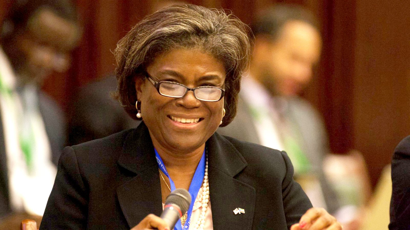 Linda Thomas-Greenfield sits down with a microphone in front of her.