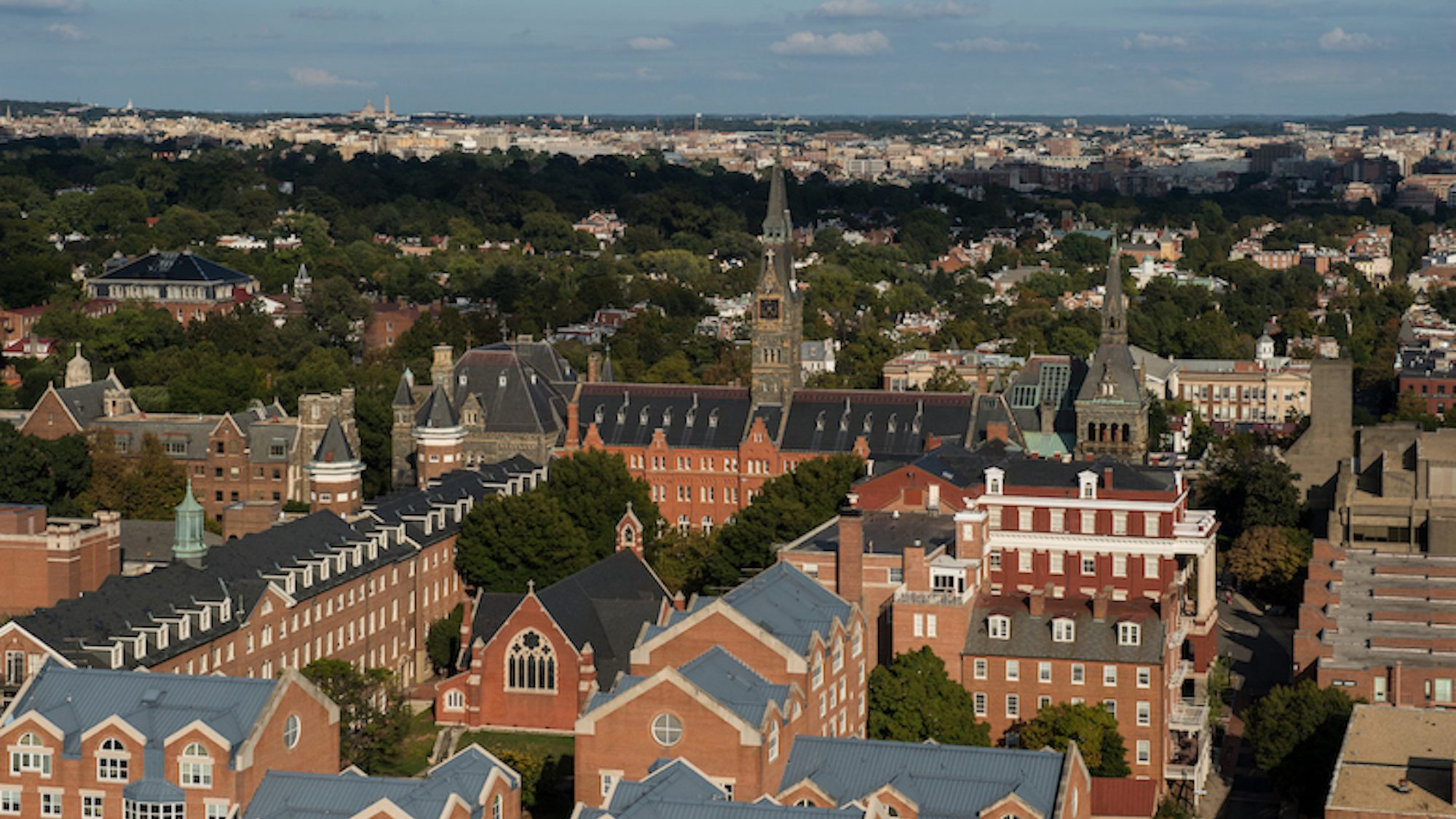 An aerial photograph of Georgetown University including the clock tower of Healy Hall