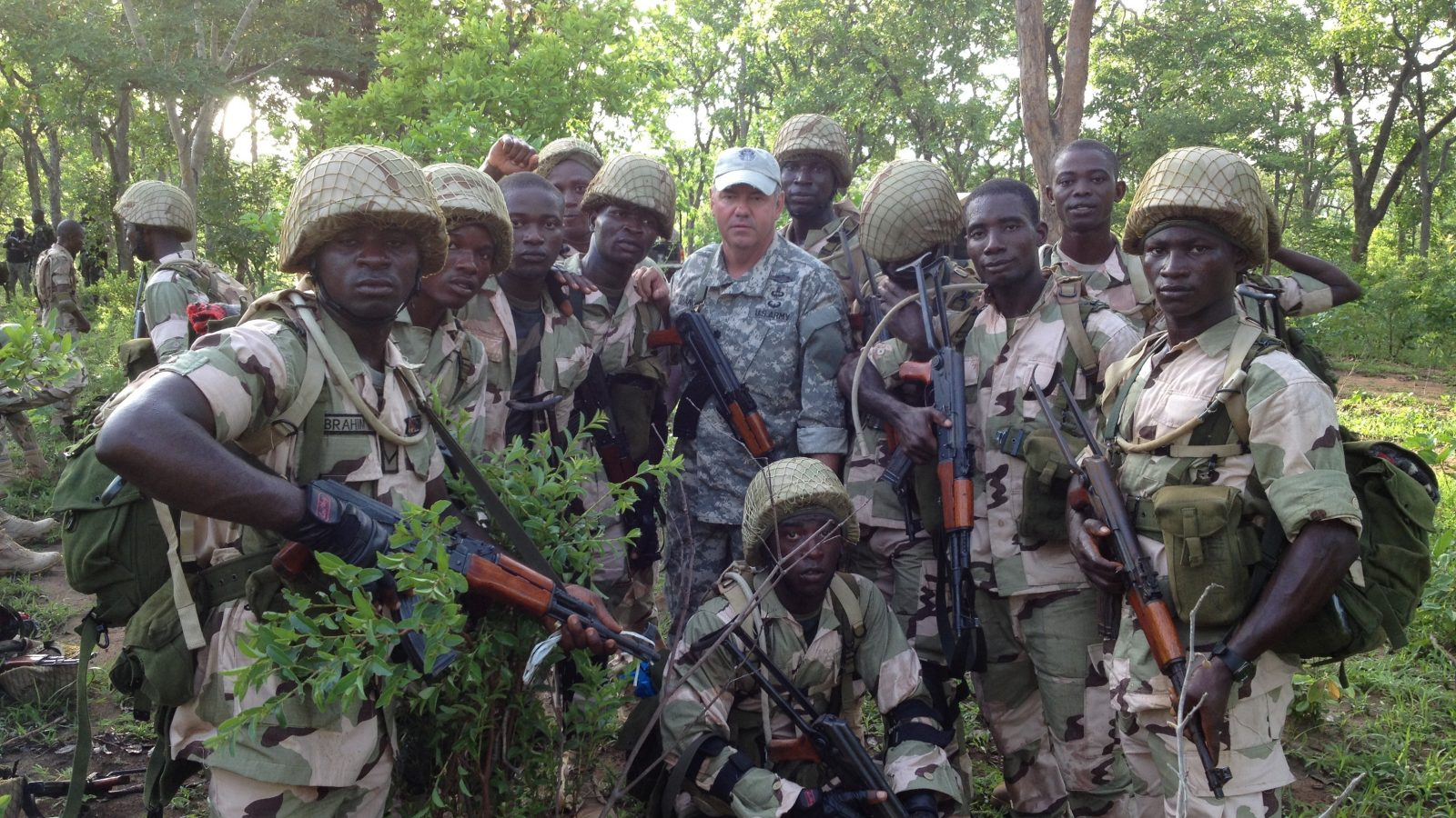 A California National Guard Special Forces soldier poses with Nigerian soldiers in 2014 during a training mission in Nigeria.