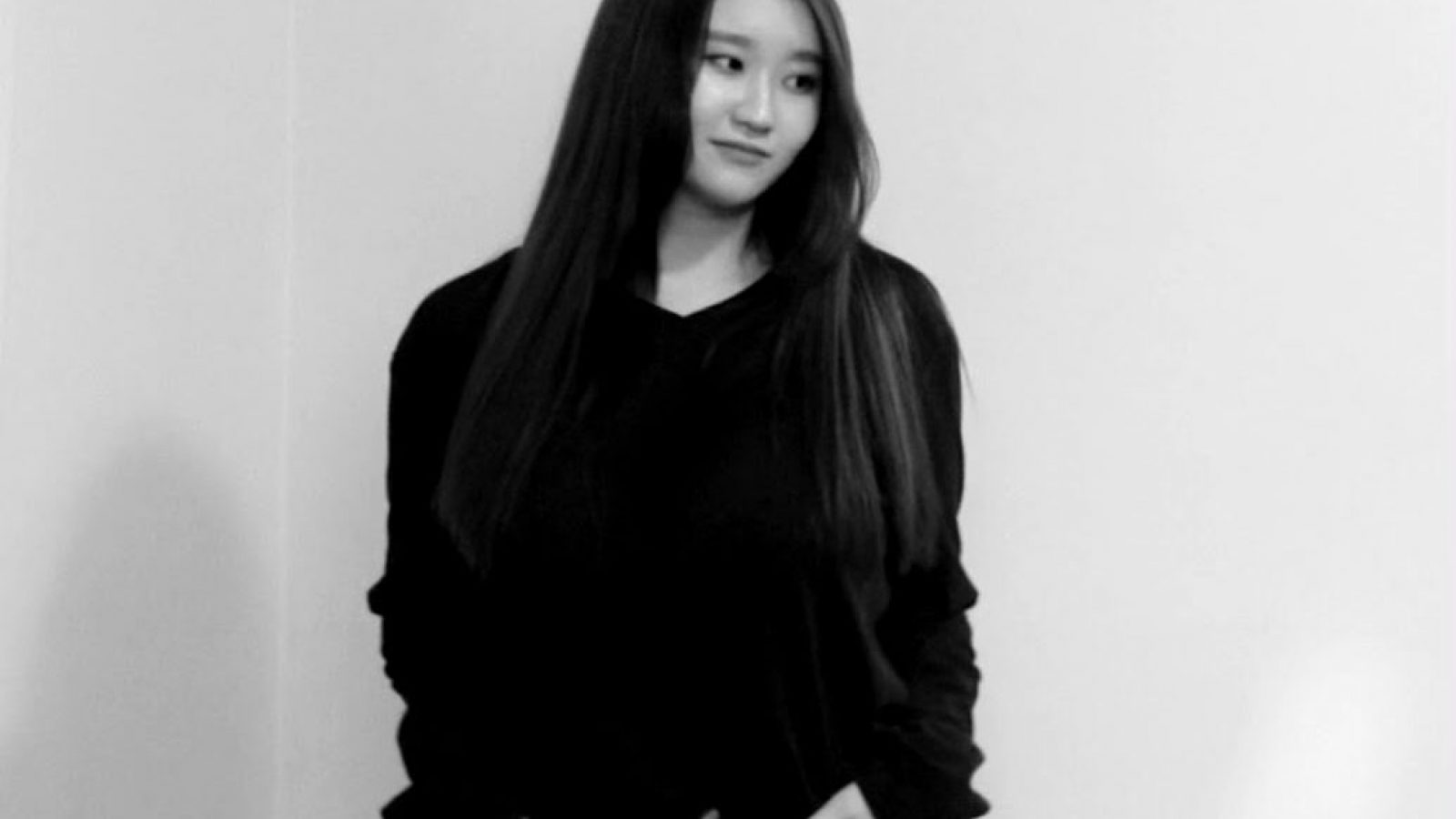 Black and white photo of Irene Chun with her hands in her pocket