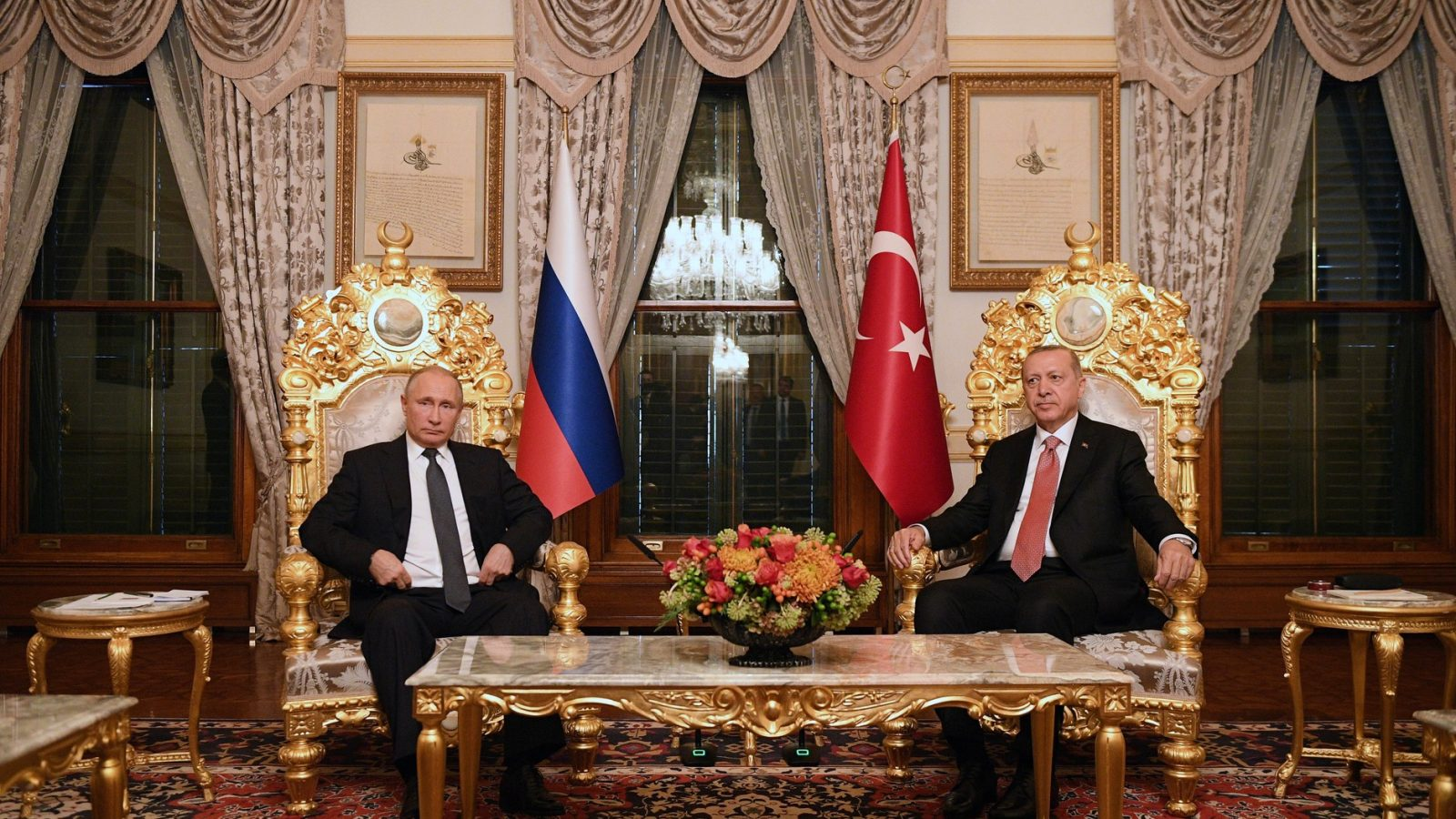Russian President Vladimir Putin and Turkish President Recep Tayyip Erdoğan sit in a luxuriously decorated room in Istanbul