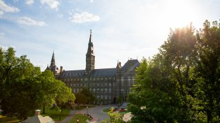 Sun shines on Healy Hall from a distance
