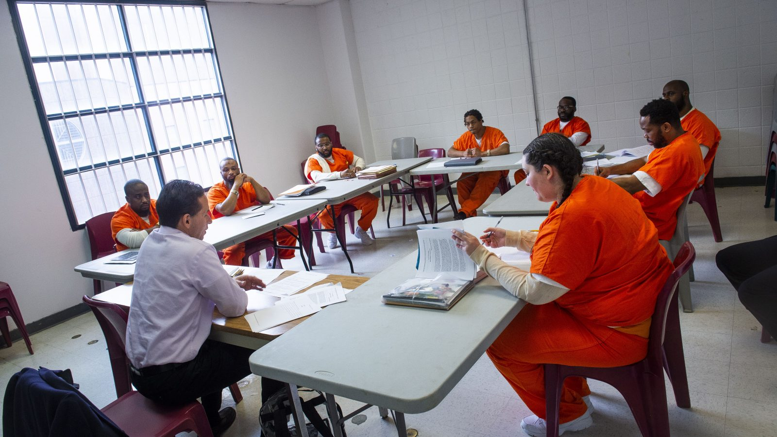 Marc Howard teaching course to incarcerated individuals