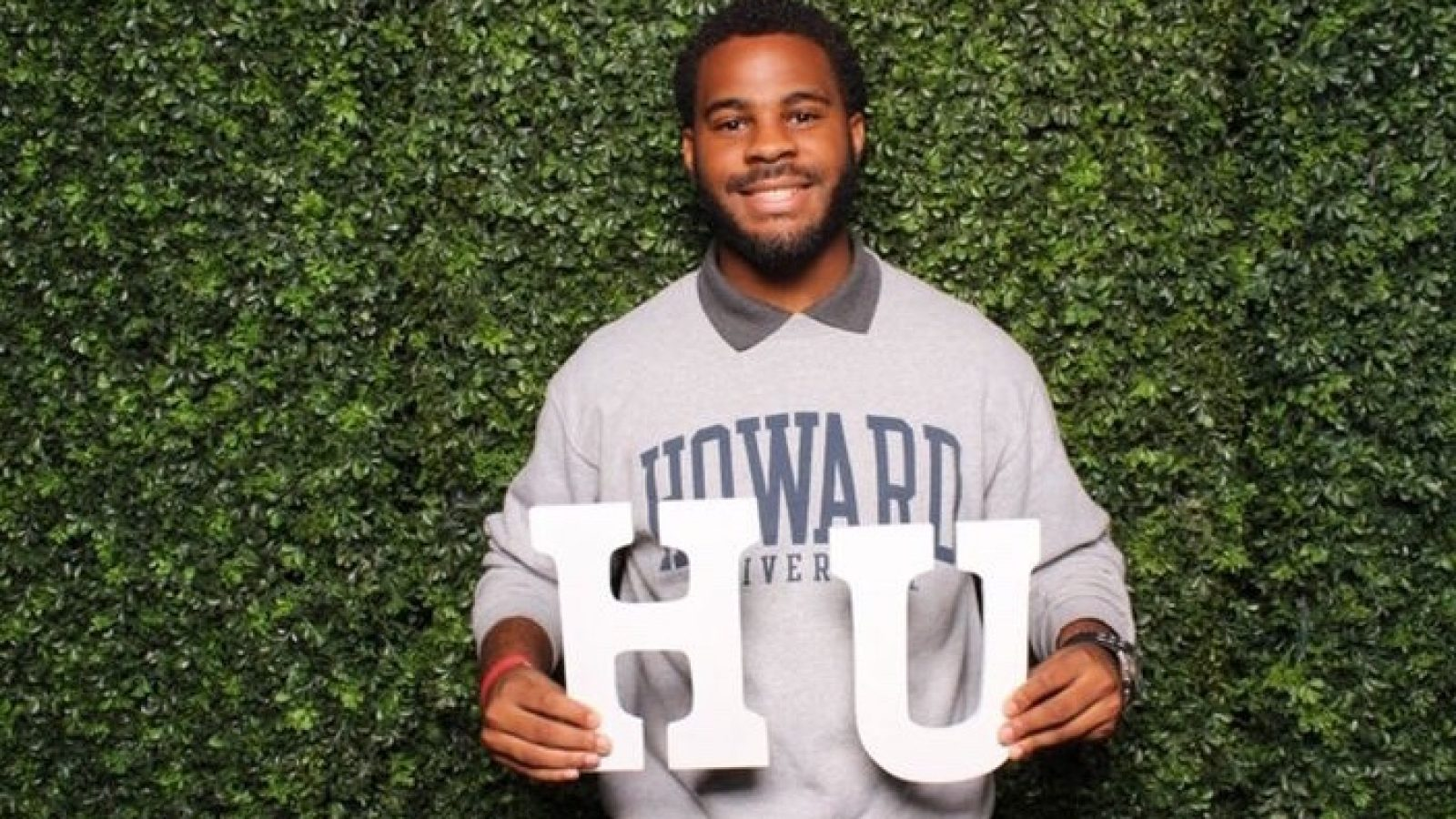 Quentin Byrd wears a Howard sweatshirt and holds