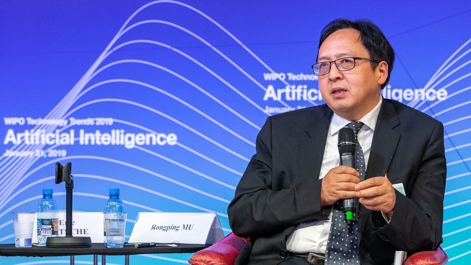 Rongping Mu, Head of the Institutes of Sciences and Development in China, speaks at a panel discussion on artificial intelligence