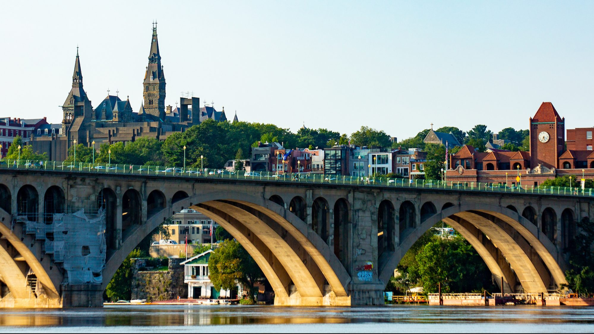 Healy Hall, Car Barn and Key Bridge from across the Potomac River