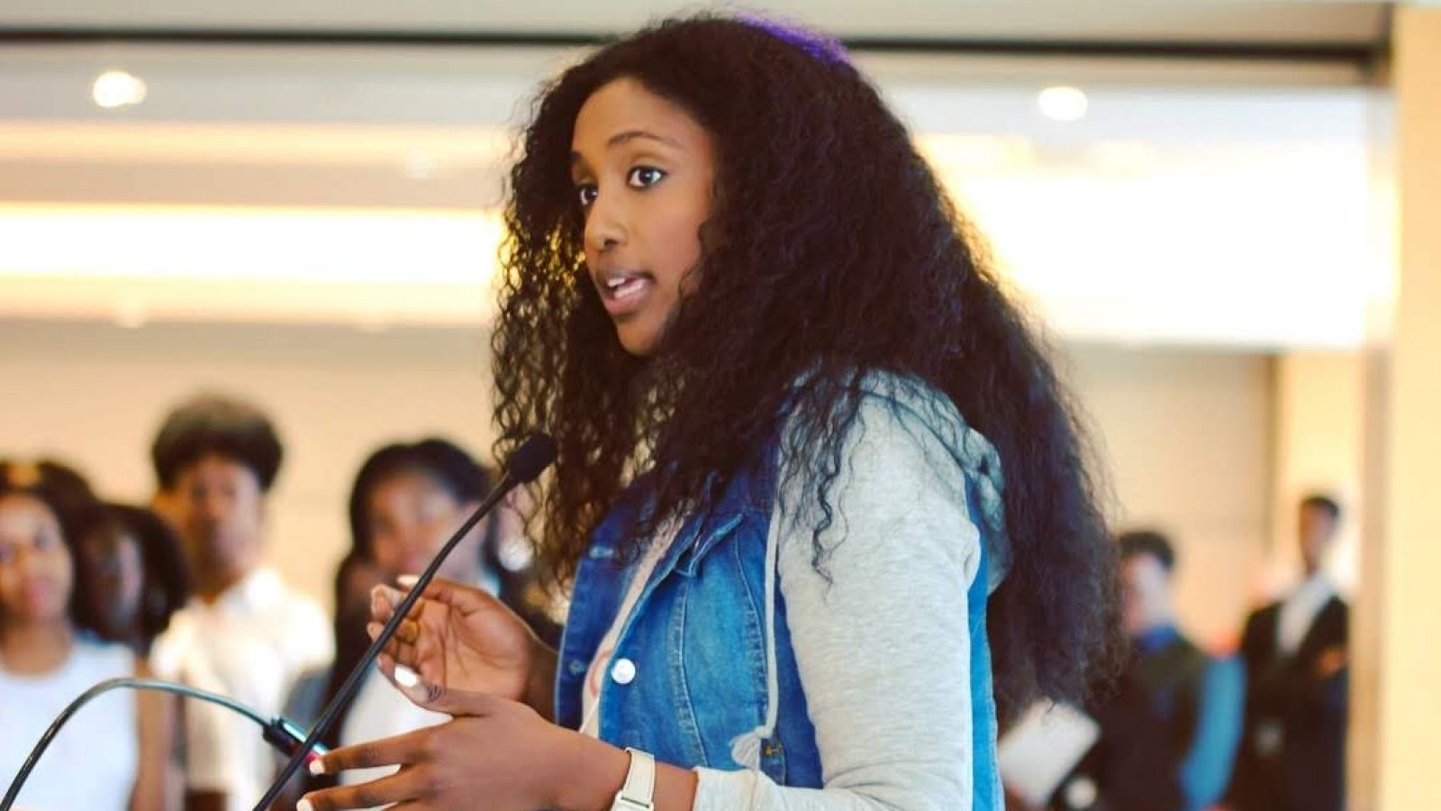 Bserat speaks to a group of Black college students from across the United States