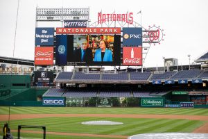 Anthony Fauci and Christine Grady on the Jumbotron at Nats Park
