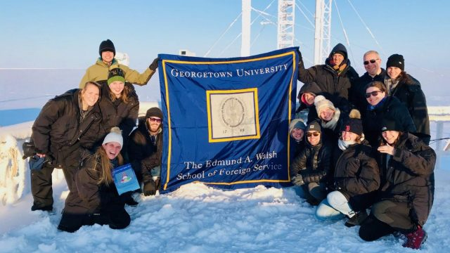 Britt and his classmates and professors atop a NOAA climate monitoring facility in the sub-zero temperatures of Utqiagvik, Alaska.