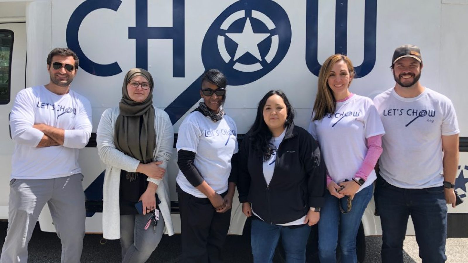 Jordan Foley and five Chow fellows stand in front of a food truck