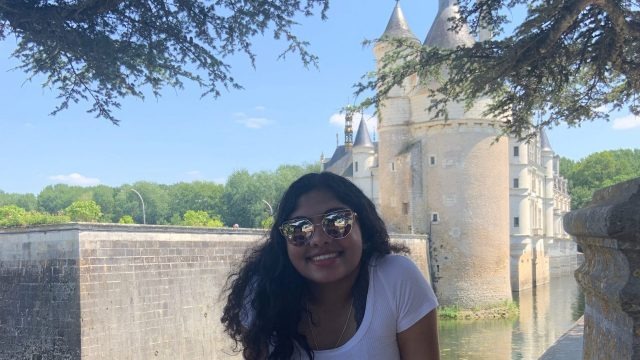 Varsha Menon in front of a castle in France