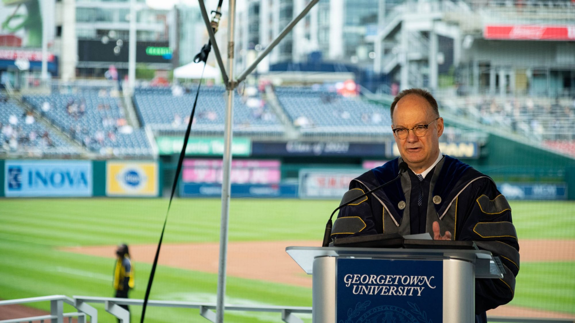 President DeGioia speaks from a podium at Nationals Park