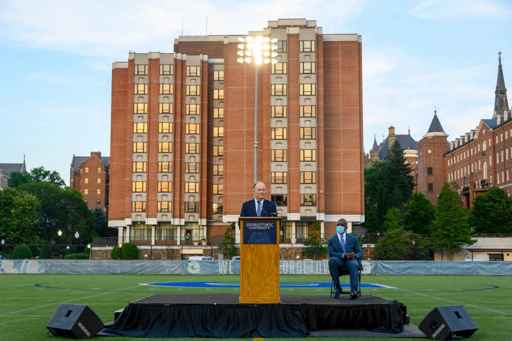 President DeGioia delivers a speech on Cooper field in front