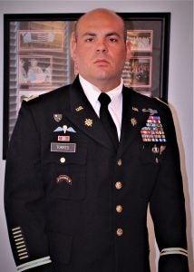 Timothy Torres wears dress Army uniform