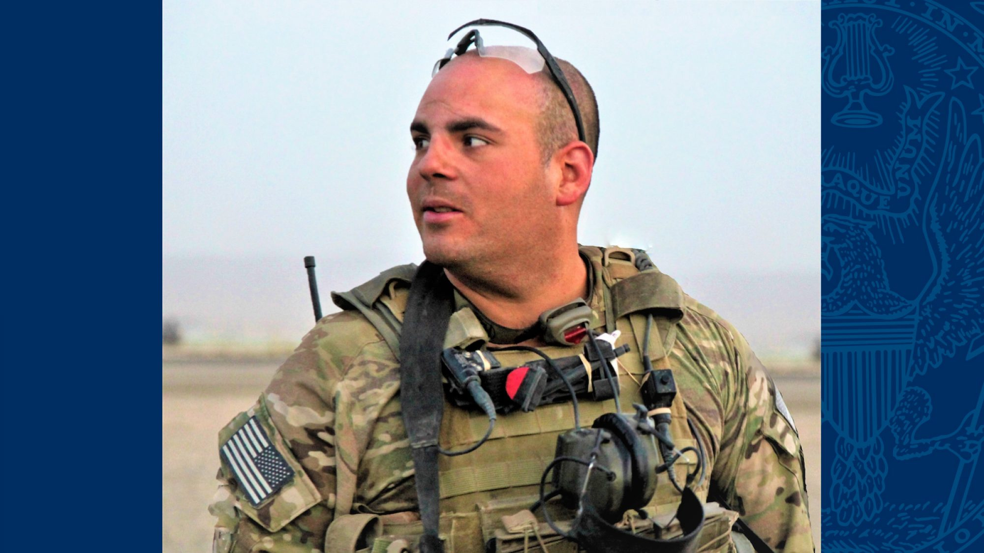 Timothy Torres wears camouflage and equipment