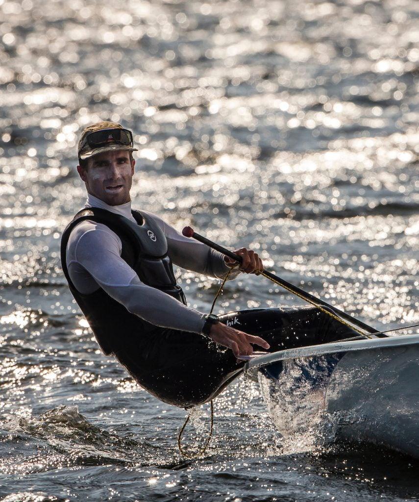 Charlie Buckingham leans back on a sailboat