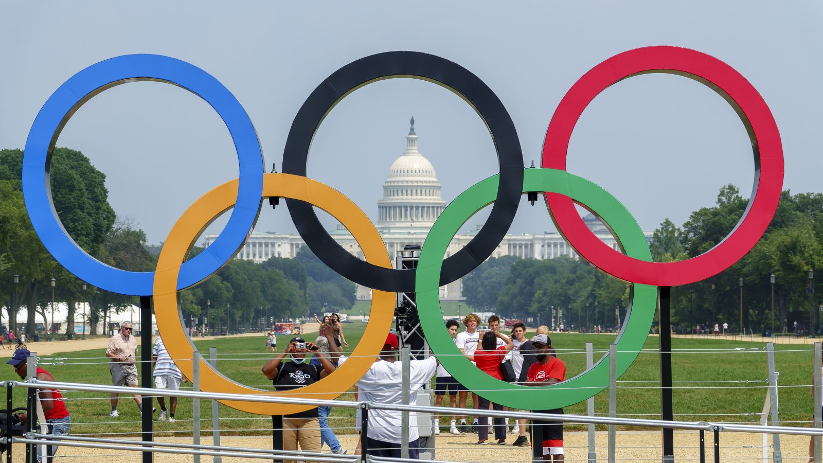Capitol Building in the background of intersection five large Olympic rings