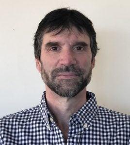 Headshot of Ophir Frieder wearing a blue gingham shirt