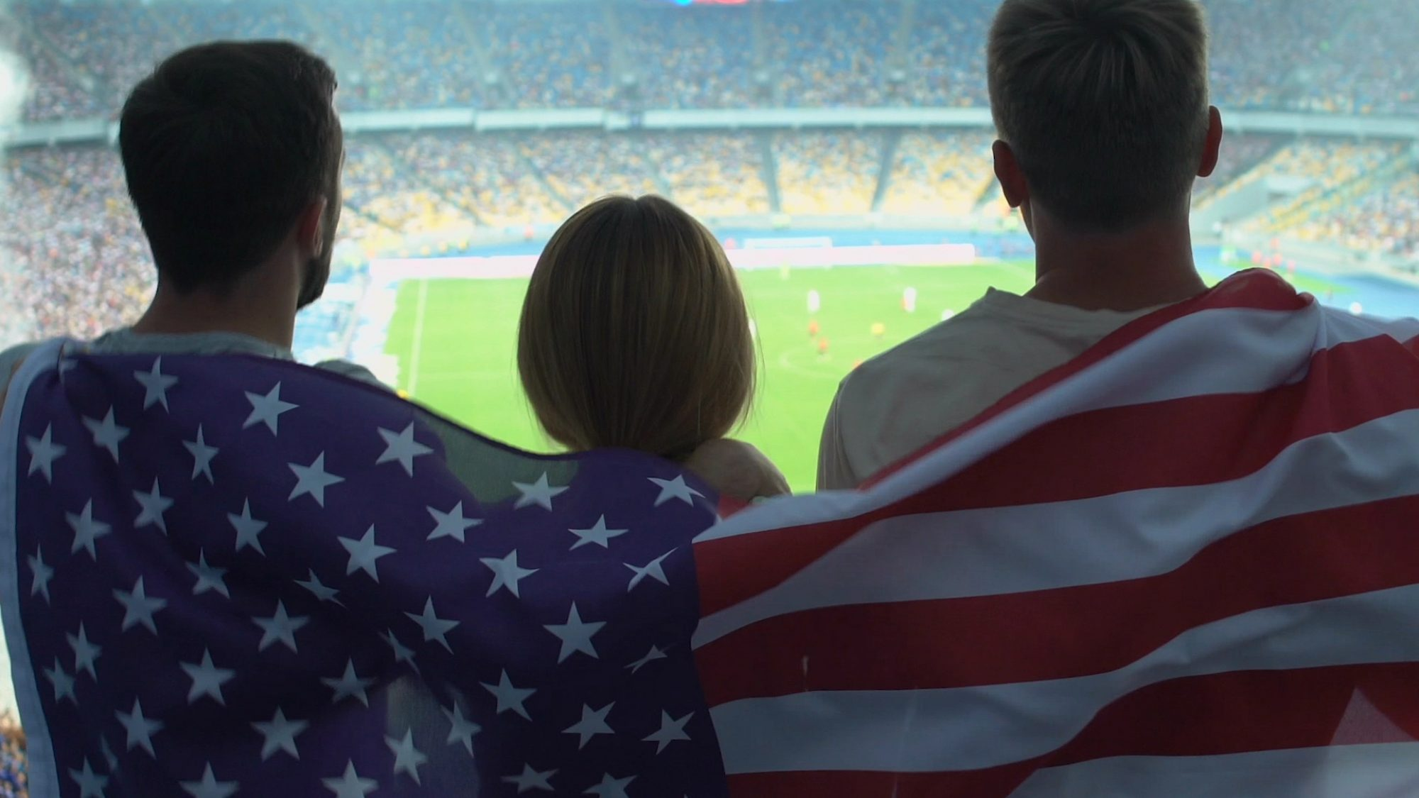 Fans in stadium with United States flag.