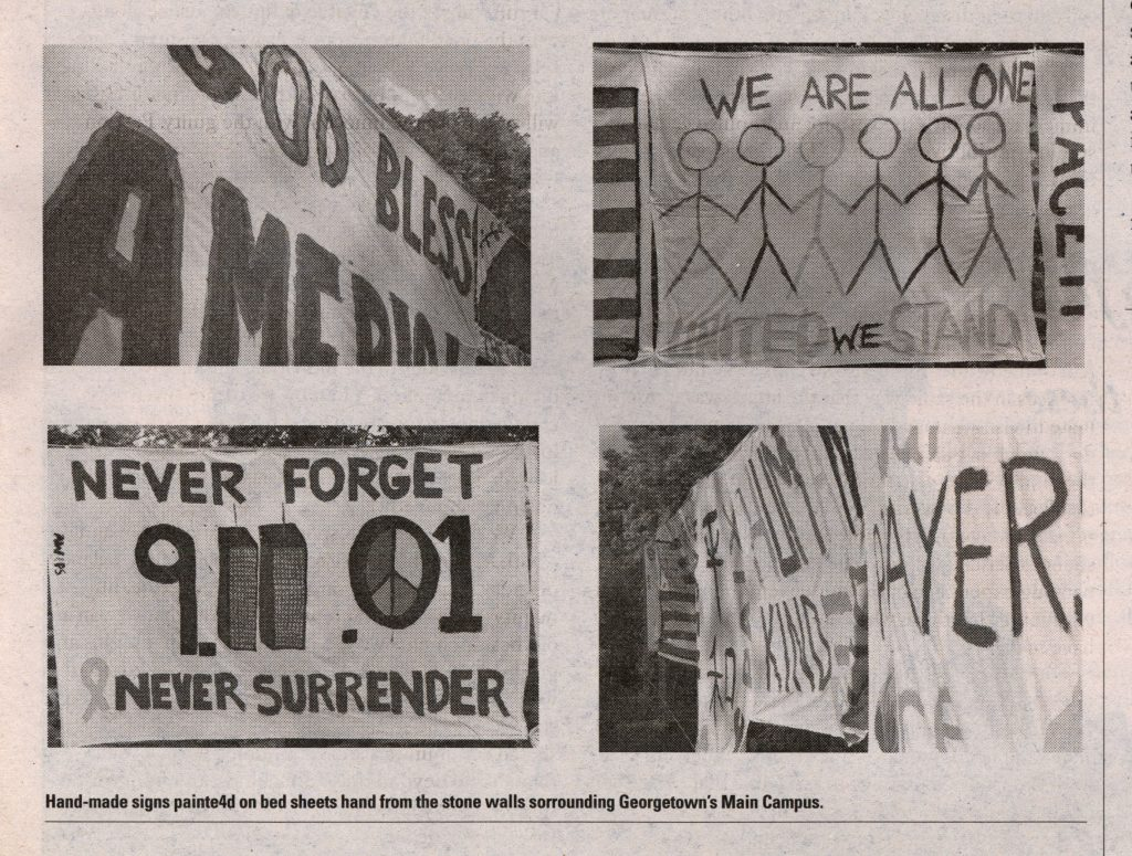 Four handmade signs conveying messages about 9/11