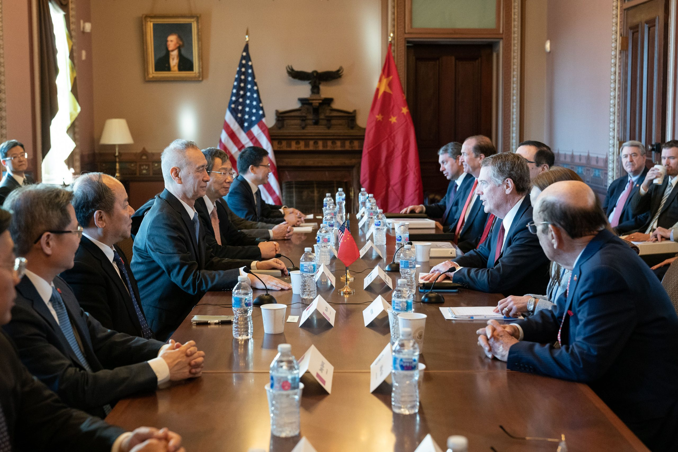 Amb. Robert Lighthizer and Chinese officials around a negotiation table