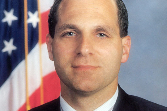 Louis J. Freeh smiles for the camera in a headshot.