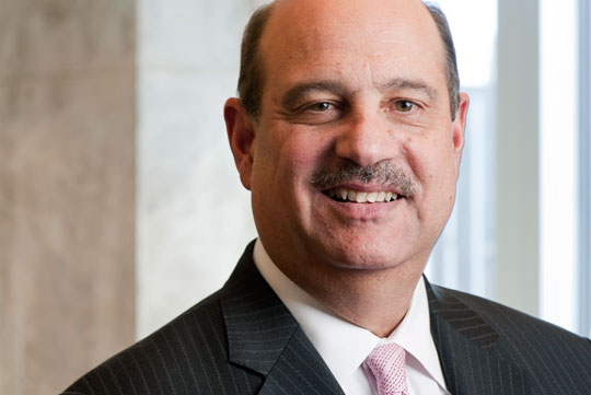 Barry Salzberg smiles in a headshot.