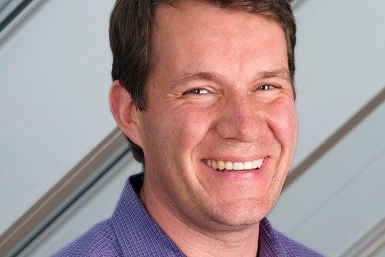 Scott Case smiles in a headshot.
