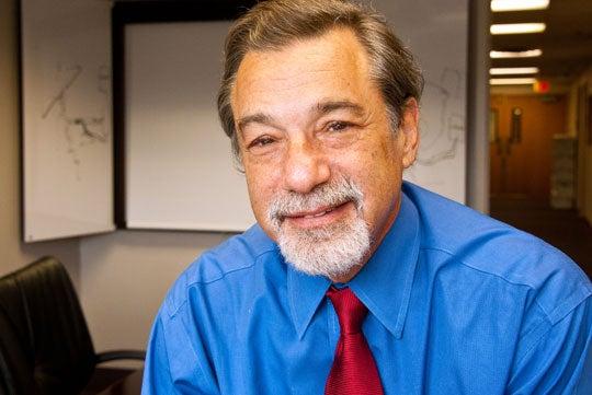 Dr. Michael Zasloff smiles in a headshot.