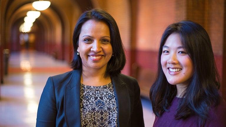 Professor Shweta Bansal and Ph.D. student Elizabeth Lee together inside a hallway in Healy Hall